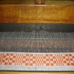 Greca terminada, a seguir tejiendo la tela de lino...